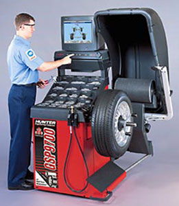 Picture of a mechanic and a wheel balance system